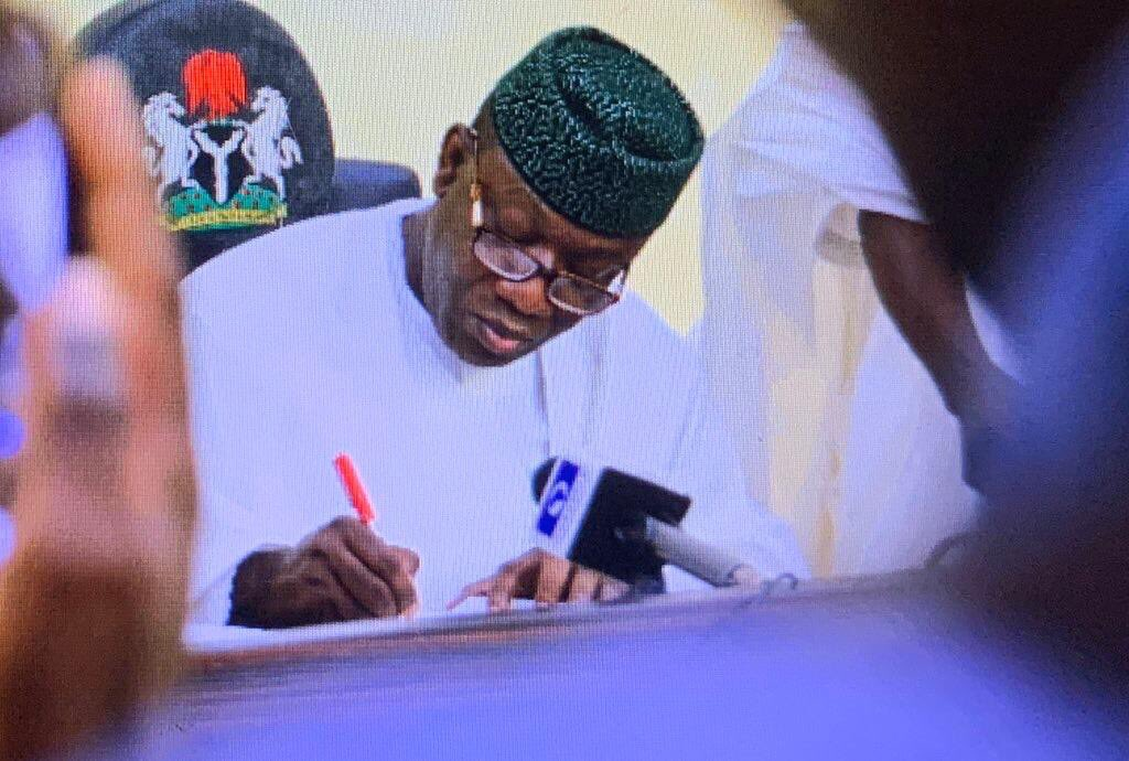 Photo of Ekiti State Governor signs new bill preventing abandonment of projects.
