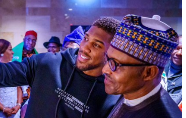 Photo of Anthony Joshua prostrates, takes Pictures with Buhari in London