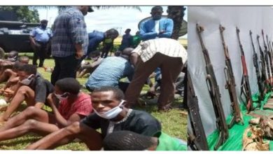 Photo of Police Parade AK-47 rifles allegedly recovered from IPOB training camps in Delta