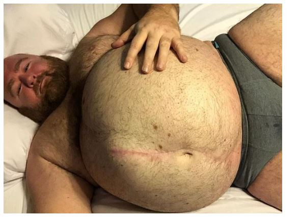 Meet erotic weight gainer who followers pay $20 a month just to watch him excite them with his massive tummy 1