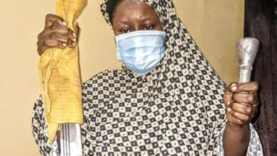 Photo of Police parade 26-year-old mother who hacked her two children to death because her husband married a 2nd wife