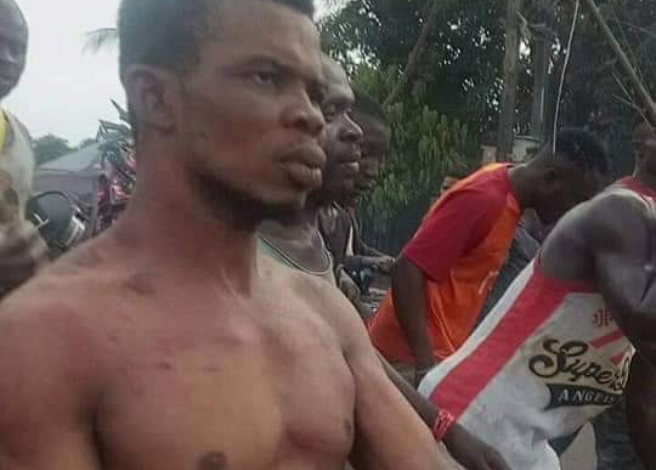 Pastor in Anambra State stripped and paraded after he was allegedly caught with charms (Photos) 9