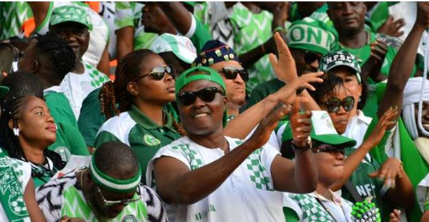Photo of Nigerians celebrate as Super Eagles beat Benin to secure AFCON qualification