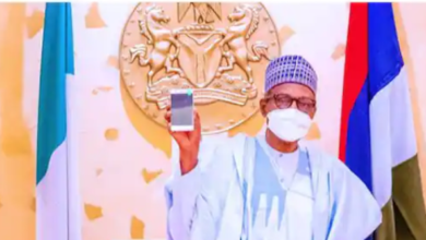Photo of Buhari takes delivery of first made-in-Nigeria cell phone